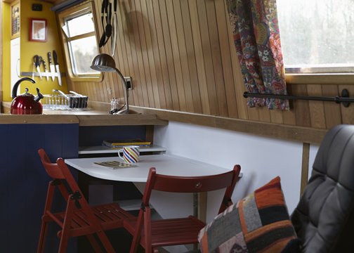 The dining area of the canal boat Queenie is cosy and stylish.